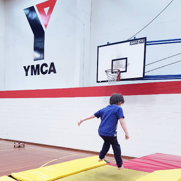 Mid-air action shot, at YMCA gymnastics for kids, we love it. Lovely instructors, nice equipment, small groups, and great for coordination and strength.