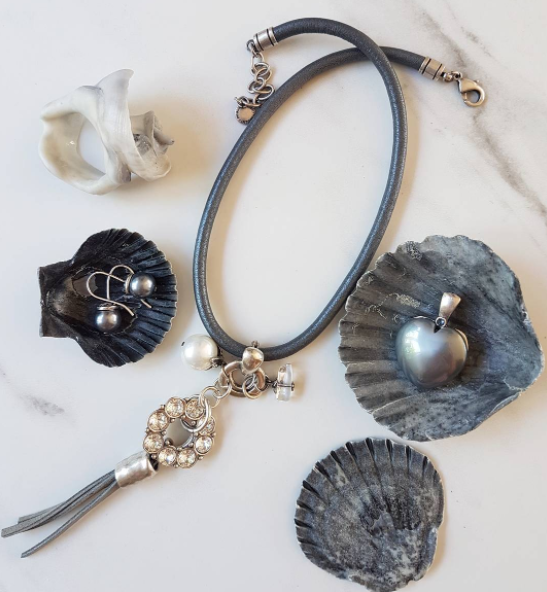 Black pearl, leather, and burnished silver jewellery