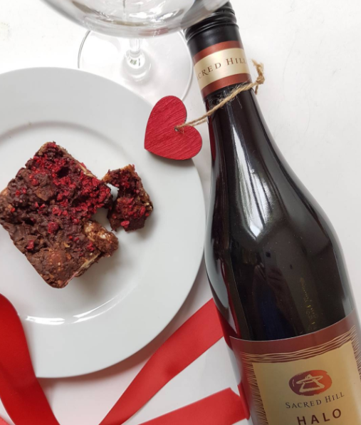 Be Wine Valentine! A beautiful delivery today from a secret admirer AKA @sacredhillwines! Decadent Rocky Road chocolate slice by Amy's Secret Kitchen, wine-matched with Sacred Hill Wines Halo Pinot Noir 2015