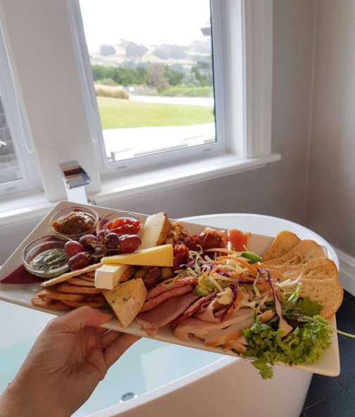 Will anyone judge me if I eat this antipasto platter in the bath? The Camp Estate hotel just dropped me off this yum platter. PS how nice is a bathtub with a mountain view?!