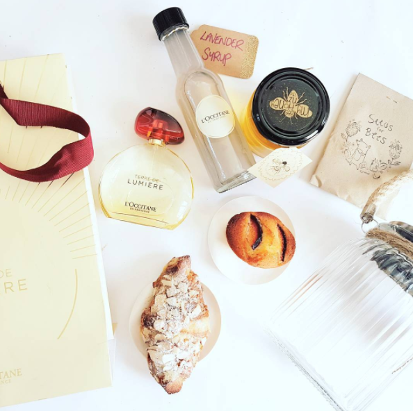 Ingredients of a perfect day in Provence in the goody bag from L'Occitane captured in their brand new perfume Terre de Lumiere: lavender, honey, and the light at golden hour. French pastries by Amano bakery.
