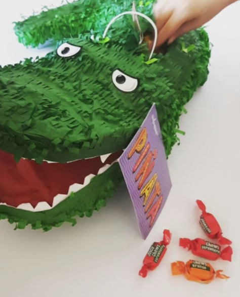 Filling our gorgeous birthday piñata crocodile from @thewarehousenz!