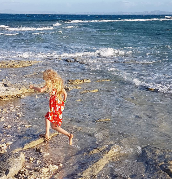Rock-hopping daughter at South Sea Island.