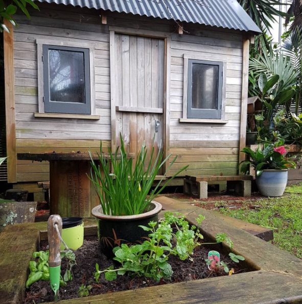 Planted my new herb garden in front of the kids playhouse at the bottom of the garden. At least herbs will enjoy the rain :)
