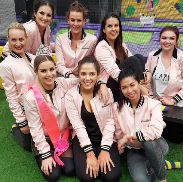 Pretty in pink: beauty bloggers in Benefit 'Bene-babes' satin jackets, on today's field trip to Jump where we got our bounce on to celebrate the launch of Boi-ing concealer.
