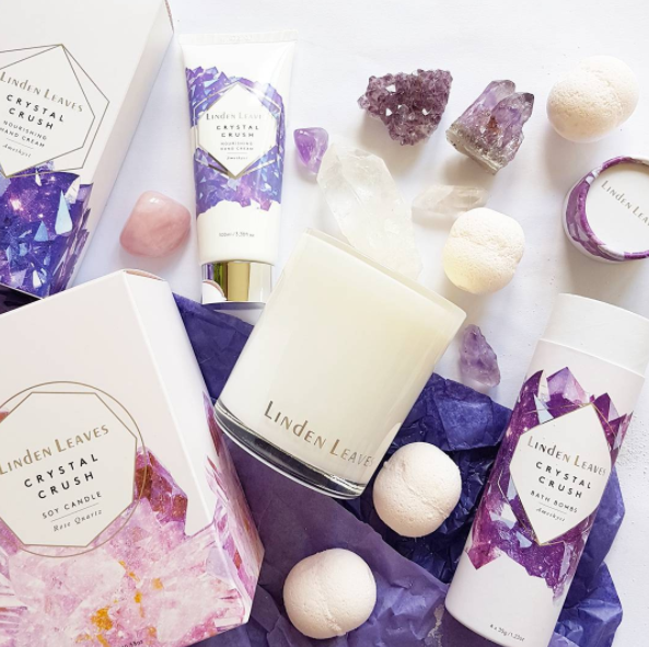 Linden Leaves Crystal Crush collection handmade in Christchurch with aromatherapy fragrances to bring happiness to your day. Rose quartz and amethyst inspired natural fragrances in bath bombs tube ($15 for 4), diffuser $40, soy candle $40, hand cream $25 and $10, and 4 mini hand creams set $30. See @lindenleaves