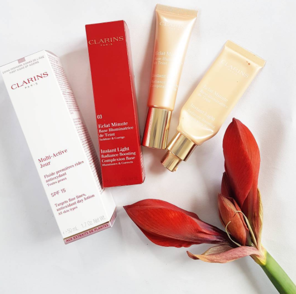 Have you tried Clarins Instant Light? It's a complexion base I wear under makeup for a dewy illuminated effect. This is one of my daily beauty faves, and the tube on the right is completely empty