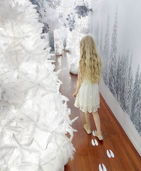 Following the reindeer footprints through the enchanted forest to see Santa at Smith and Caughey's