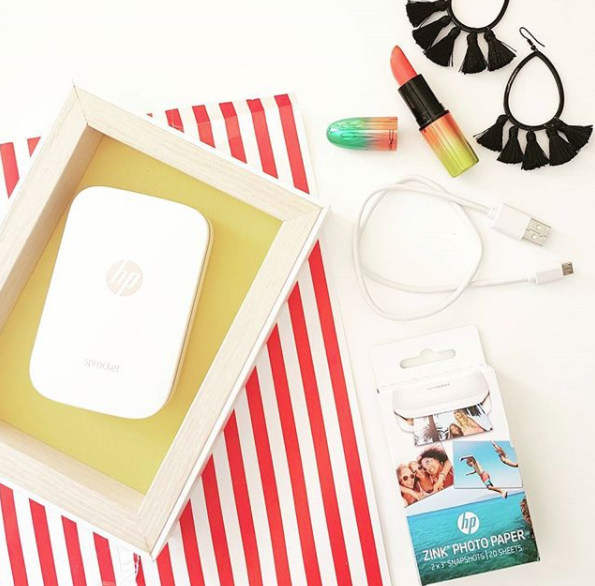 """This device looks perfect for anyone who takes lots of phone photos but never prints them out; the hp sprocket instantly prints 2x3"""" photos on photo paper using the app and you can add stickers, text, emoji etc."""