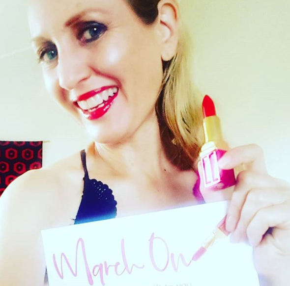 Supporting the March On campaign with Elizabeth Arden and wearing Red Door Red which she gave out to suffragettes marching in the streets for women's rights. You can empower women when you give a Elizabeth Arden signature lipstick, as 100% of proceeds go to @UNWomen.